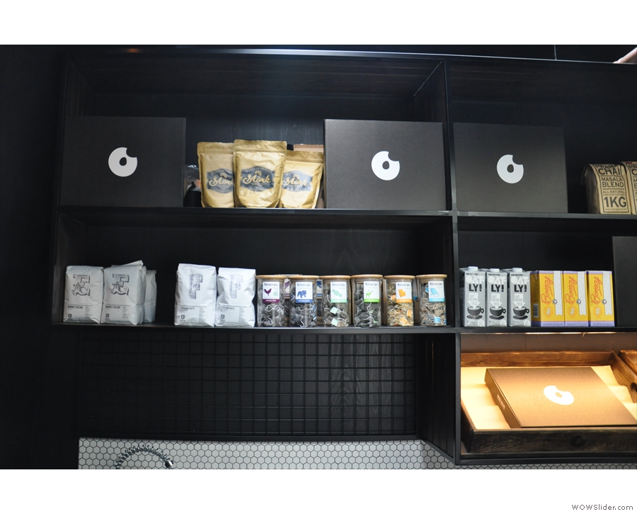There's coffee, tea, hot chocolate and more on the shelf behind the espresso machine...