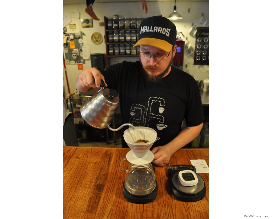 This is Lennon, my barista, carrying out the first pour.