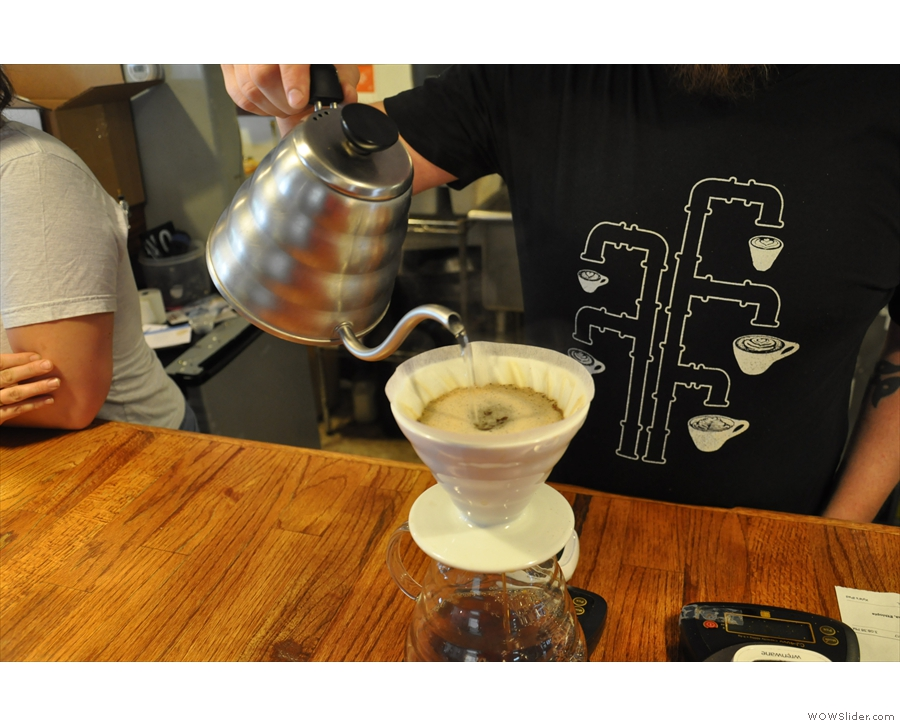 ... slowing topping up the V60 until the correct amount has been added.