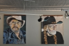 Various large portraits hang in the front part of Johnson Public House.