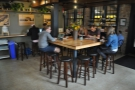 The room is dominated by the square, communal table right in the middle...