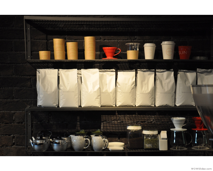 There's plenty of coffee stcked up on a shelf behind the counter...
