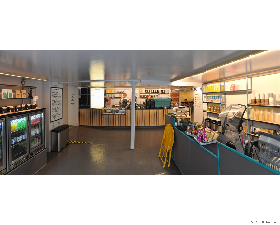 A short, wide corridor leads straight ahead to the counter, while the seating's off to the...