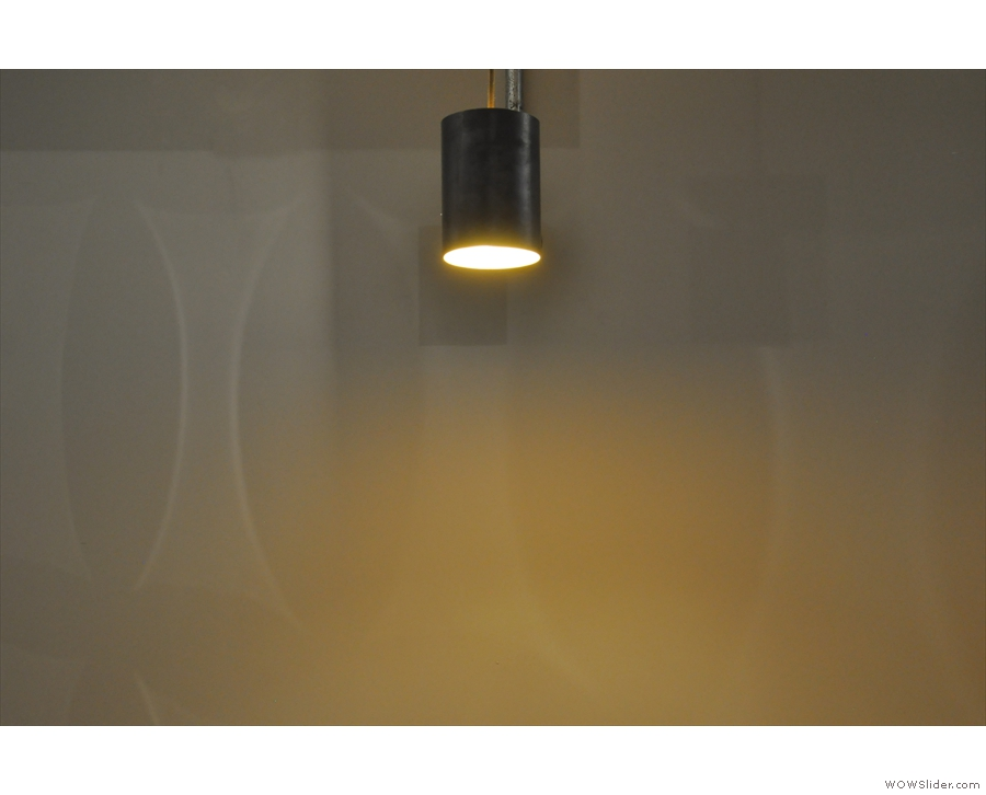 A solitary cylindrical light on the wall.