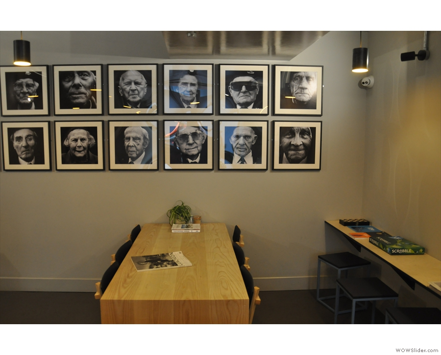 There's a six-seater communal table at the back, with interesting pictures on the walls...
