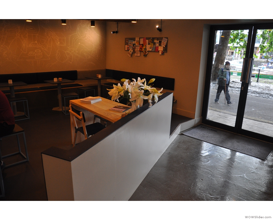 Off to the left, in effect at the back of Society Cafe, is a large, open seating area...