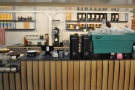 The espresso machine & its two grinders are off the right, with filter coffee at the back.