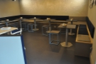 ... that consists of benches with tables running around three of the walls.