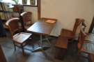 This is on the left, although it's technically a pair of two-person tables pushed together.