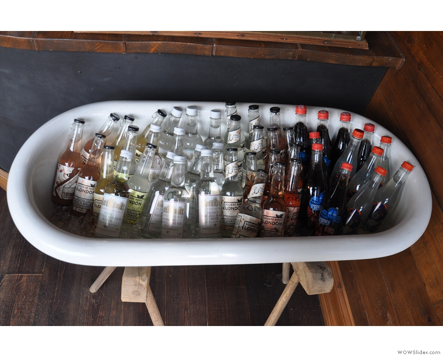 ... while this old bath tub has been re-purposed to display the soft drinks.