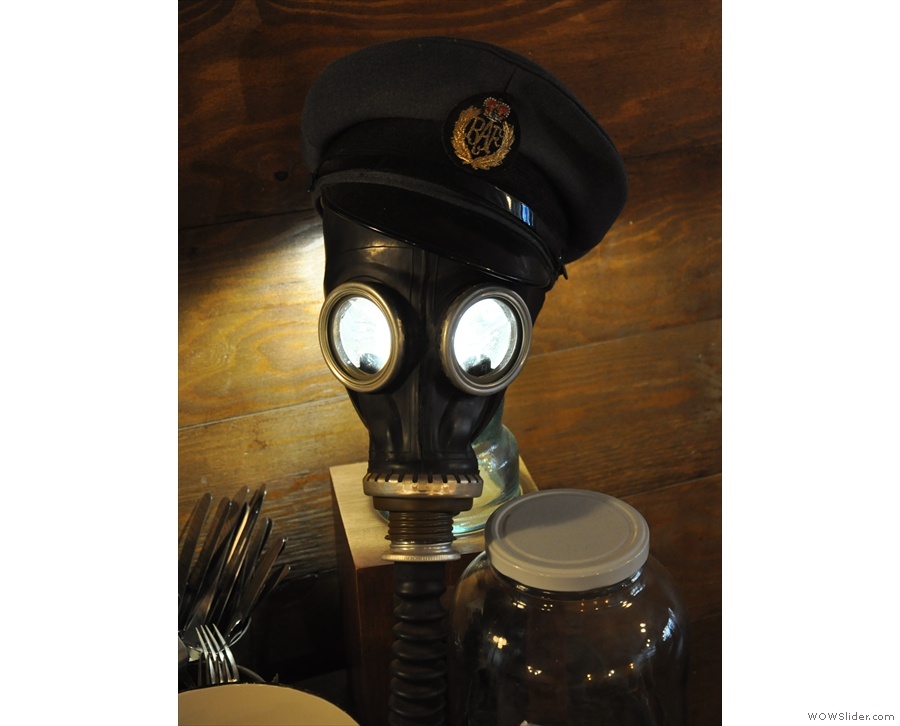 ... while this old gas-mask has been pressed into service as a light-fitting.