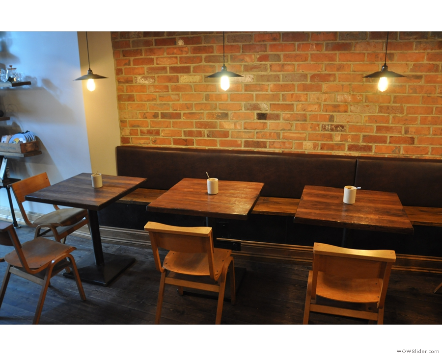 Next, more seating, starting with these two-person tables along the left-hand wall...
