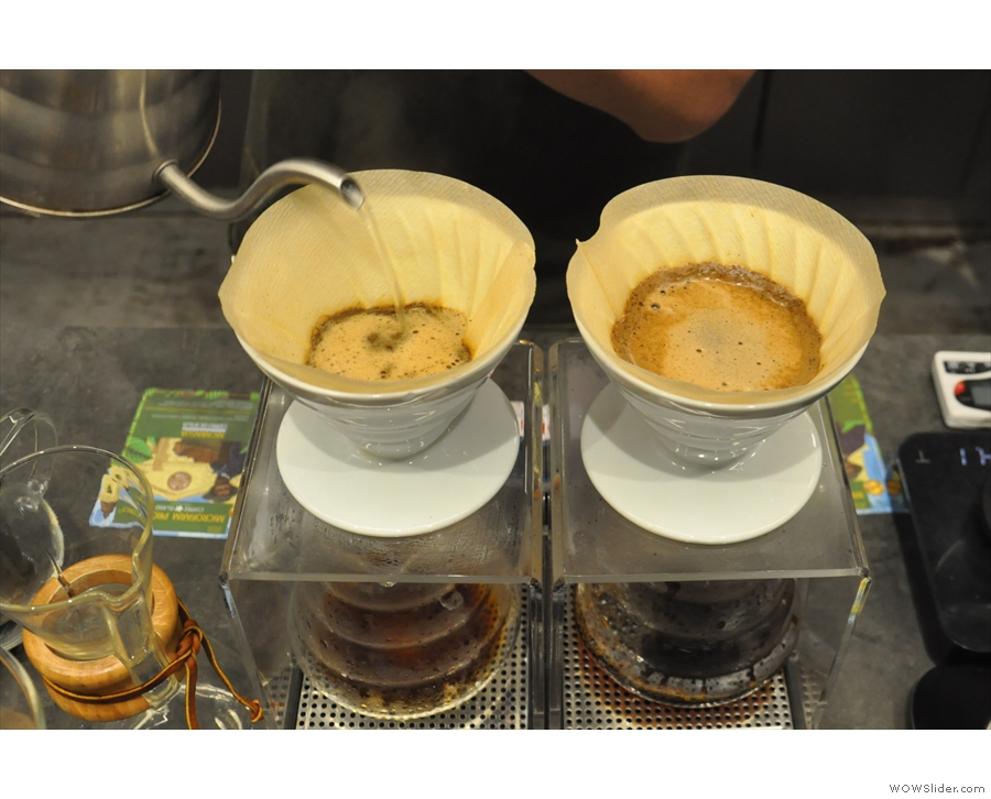 While that filters through, the barista starts the main pour on the second V60.