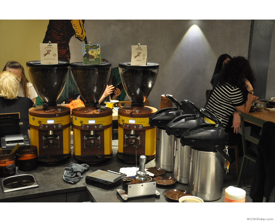 The three-group Black Eagle has three grinders, branded in Coffee Island colours.