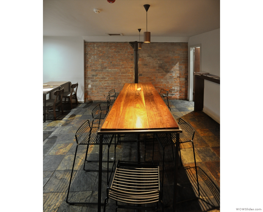The second part of the basement is dominated by this long communal table.
