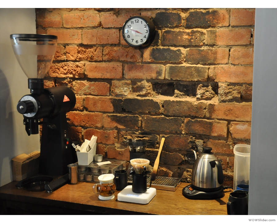 Meanwhile, in a niche in the back wall, is the pour-over area, complete with EK-43 grinder.