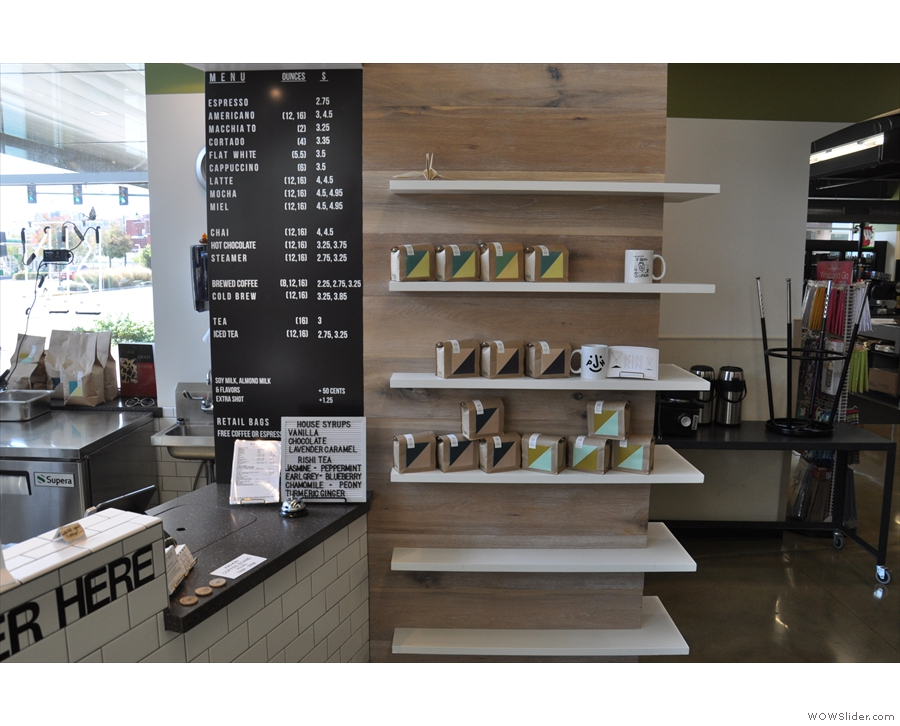 Kin-Kin is a roaster, coffee shop and retailer, with shelves to the right of the counter...