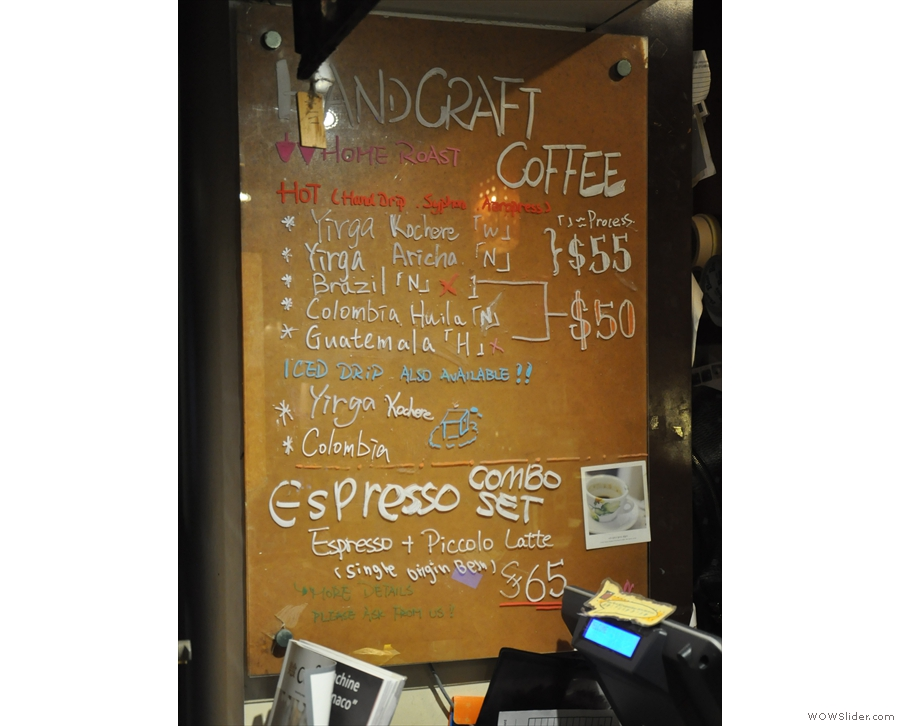 The beans/preparation methods are listed on this menu board next to the entrance.