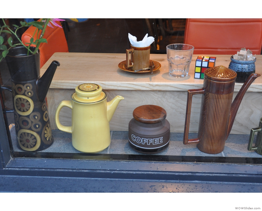 There's a display of interesting, old coffee pots in the window...