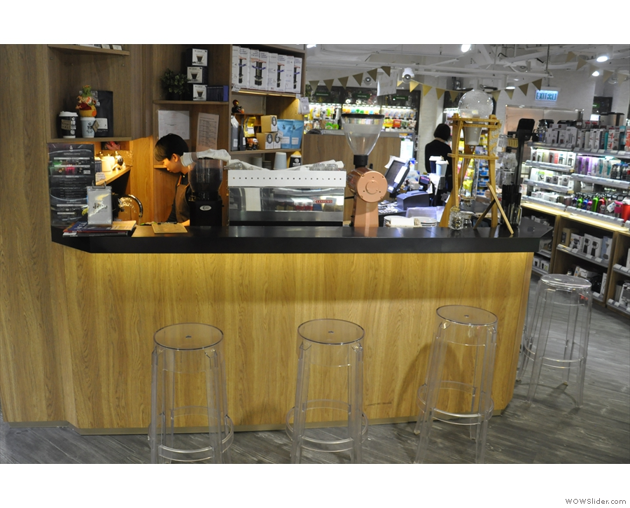 ... the triangular-shaped 18 Grams coffee stand. You can sit at either side of the counter.