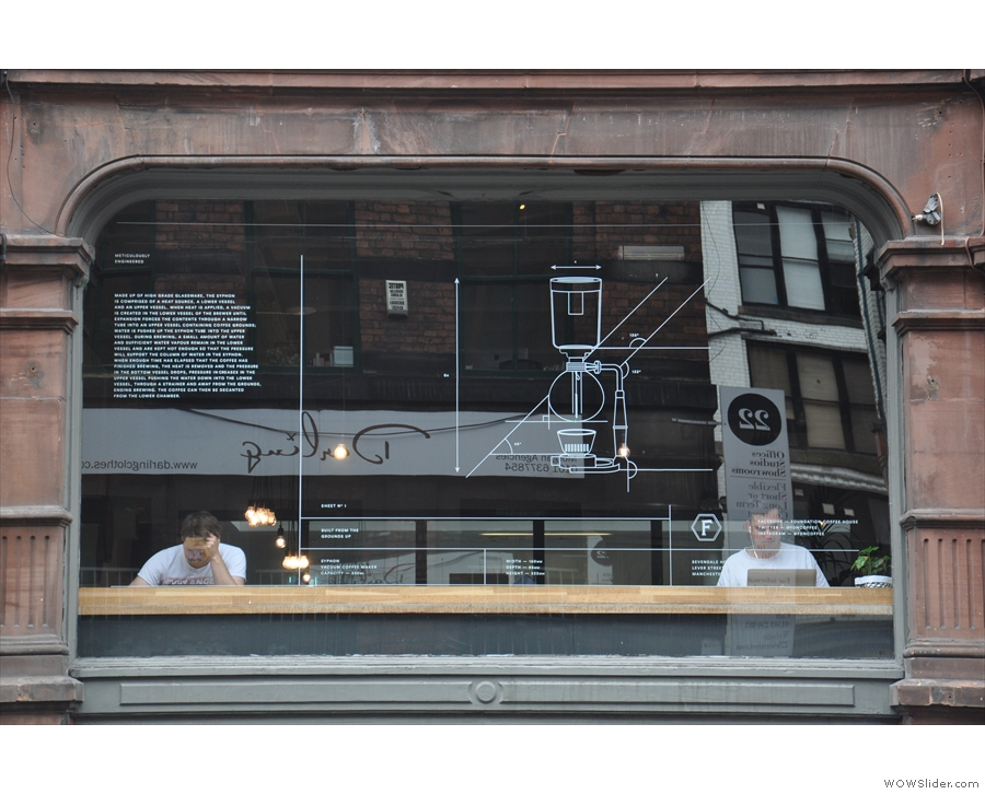 Foundation has some lovely window art: this one contains a picture of a coffee syphon.