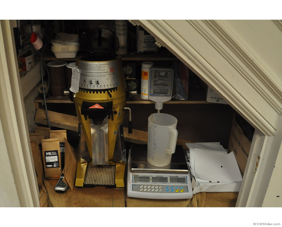 There are scales (and a grinder, if it's needed) under the stairs for retail sales.