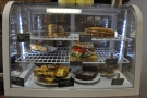 As well as coffee, there's a limited food offering, displayed at the back of the counter.