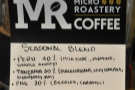 Details of the seasonal house blend are displayed on the grinnder.