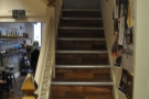 A flight of stairs on the left leads upstairs...