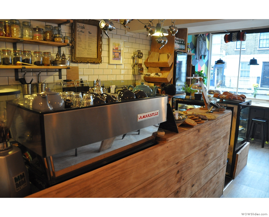 The counter is organised with the espresso machine down the side...