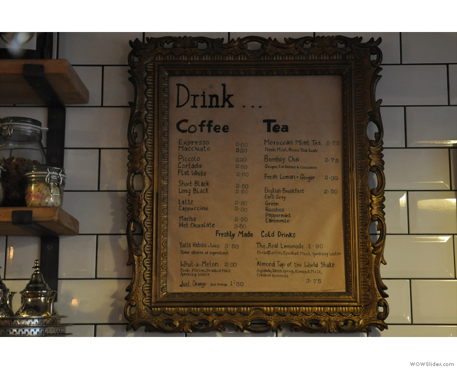 ... while you'll find the drinks menu, framed on the wall.