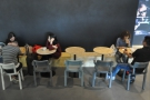 AUNN Cafe has a range of seating, including this bench and tables.