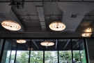 Despite bieng lined with windows, the cafe has lots of lights.