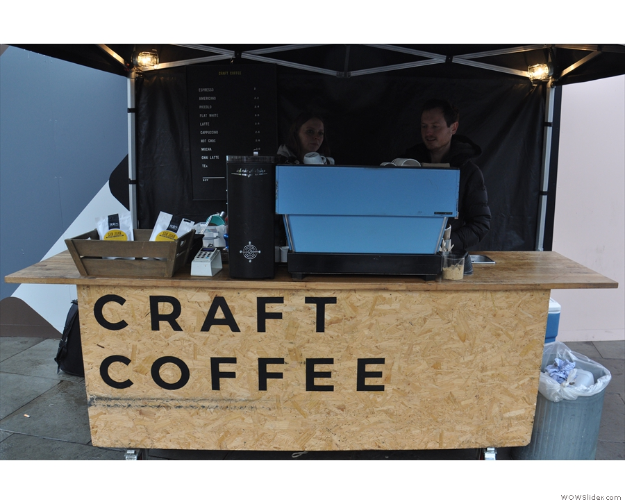 The stall's simplicity itself: counter, espresso machine & grinder, all protected by a gazebo.