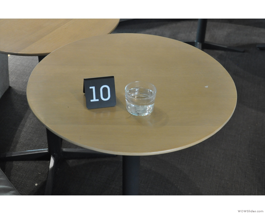 Once you order, you get a number and a glass of (warm) water while you wait.
