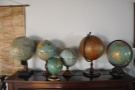 I was also taken by the collection of globes on top of the piano.