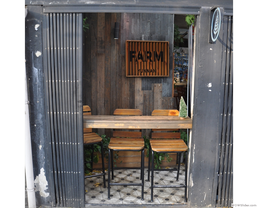 The outside seating is split into two. There's this three-person bar to the left...