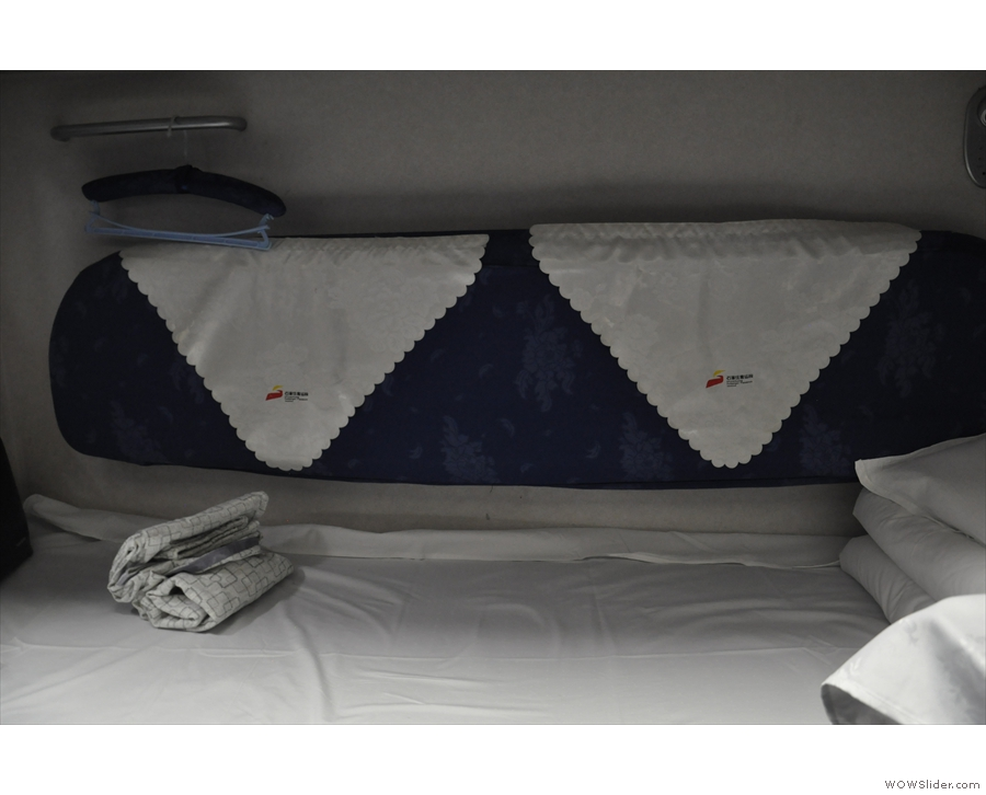 Padded cushions at the back allow the lower bunk to be used as seating during the day.