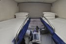 Inside, there are two bunks (upper and lower) on either side...