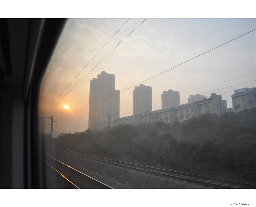 Not long after dawn as the train speeds towards Shanghai.