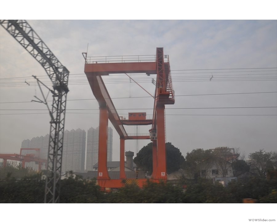 The cranes, for lifting the containers, are huge.