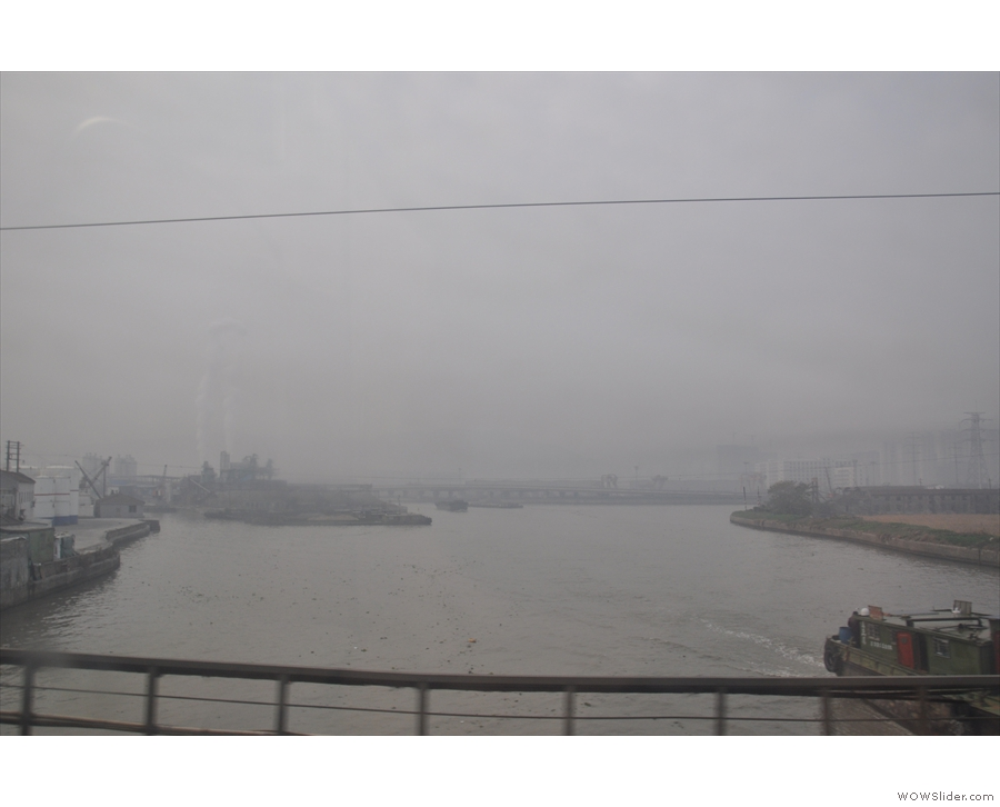 We also cross several rivers, all of which are packed with large cargo boats.