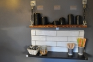 To the right, on the wall, a clever hanging tray arrangement acts as the takeaway station.