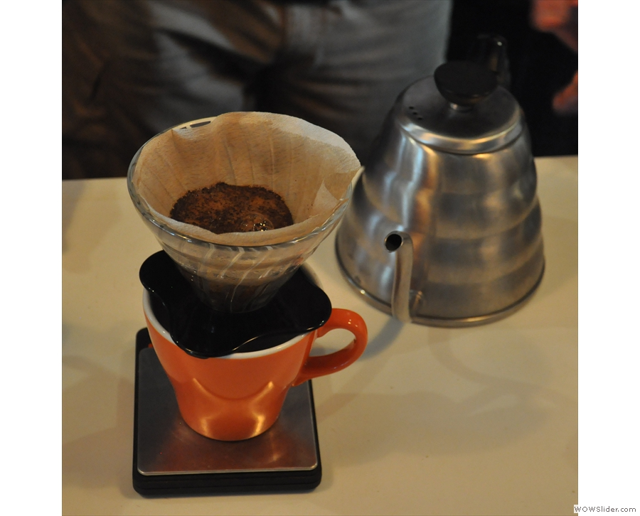 ... pausing between each pour to let the coffee filter through.