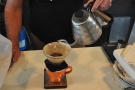 Next, we top the V60 up in a series of short, controlled pours...