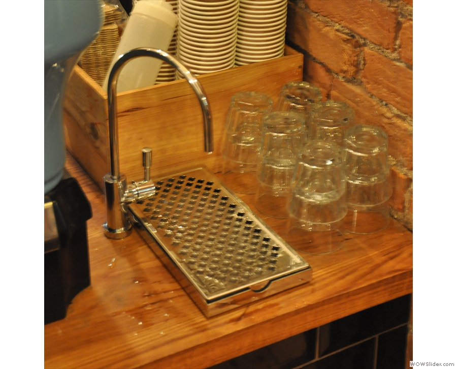 One minor change: there's now a tap by the espresso machine rather than bottles of water.