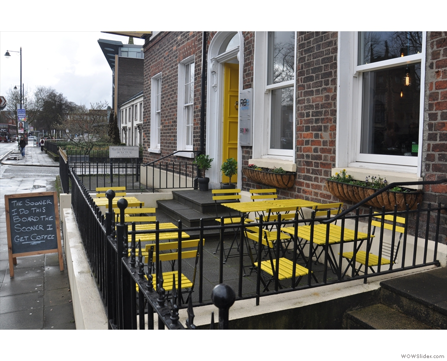 ... where your eye is caught by the bright yellow tabes/chairs out front.