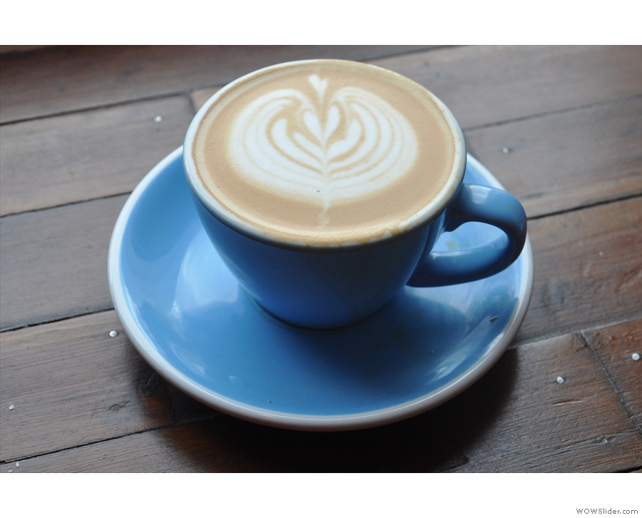My flat white, served in a beautiful, classic blue cup...
