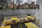 You can look out over the outdoor seating and across the road to Queen's University.