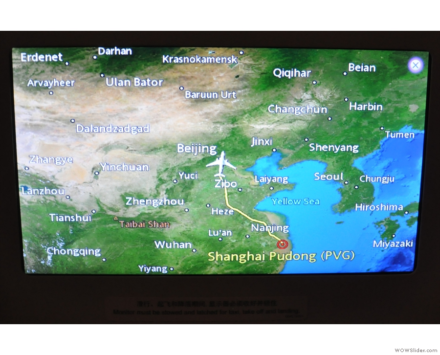 As the meal is cleared away, we pass close by Beijing, still heading north...